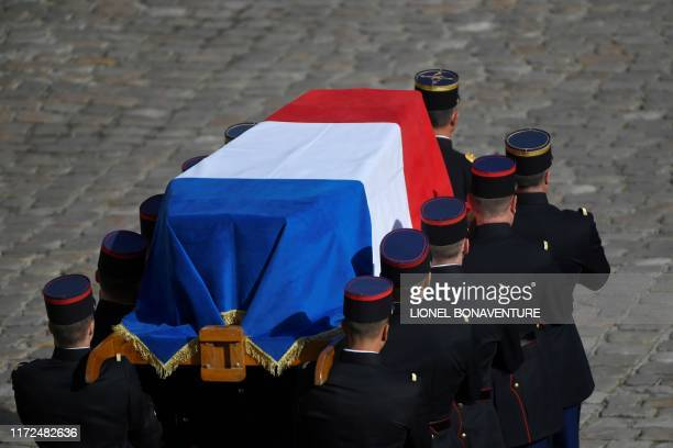 TOPSHOT Republican Guards carry the coffin of former French president Jacques Chirac during a military tribute at the Invalides in Paris on September...