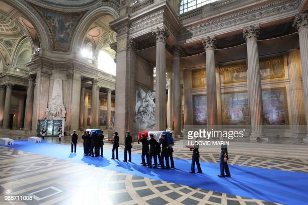 Republican Guards carry the coffins of former French politician and Holocaust survivor Simone Veil and her husband Antoine Veil to the Pantheon's...