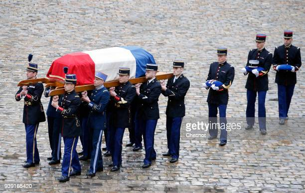 Republican Guards Gendarmes and Cadets from the jointarmy military school carry the coffin of LieutenantColonel Arnaud Beltrame during a solemn...