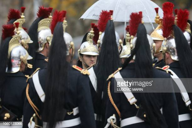 Republican guards wait prior to take part in a ceremony at the Arc de Triomphe in Paris on November 11 2018 as part of commemorations marking the...