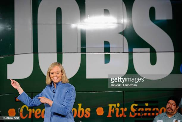 Republican gubernatorial candidate and former eBay CEO Meg Whitman speaks standing in front of her campaign touring bus at Earth Friendly Products...