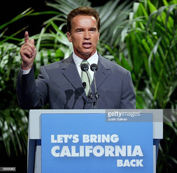Republican gubernatorial candidate Arnold Schwarzenegger gestures as he unveils his governing agenda for the first 100 days of his administration...
