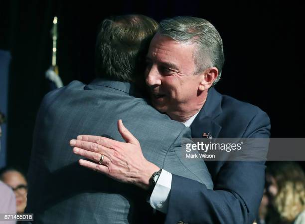 Republican gubernatorial candidate Ed Gillespie embraces a supporter before speaking at an election night rally on November 7 2017 in Richmond...