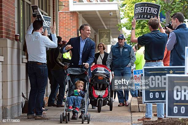Republican gubernatorial candidate Eric Greitens with son Joshua makes his way to cast his vote on Tuesday, Nov. 8, 2016 at the St. Louis Public...