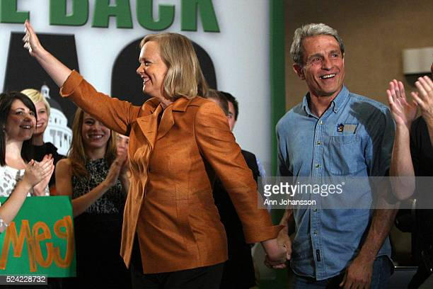 Republican gubernatorial candidate Meg Whitman's hand is held by Ed Buck as Whitman walks in to a town hall meeting held at Renaissance Hotel Spa in...