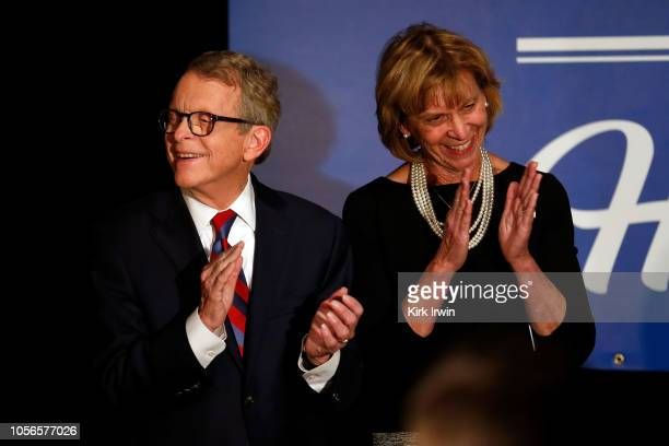 Republican Gubernatorial Candidate Ohio Attorney General Mike DeWine and his wife Fran DeWine applaud as Ohio Governor John Kasich speaks during a...