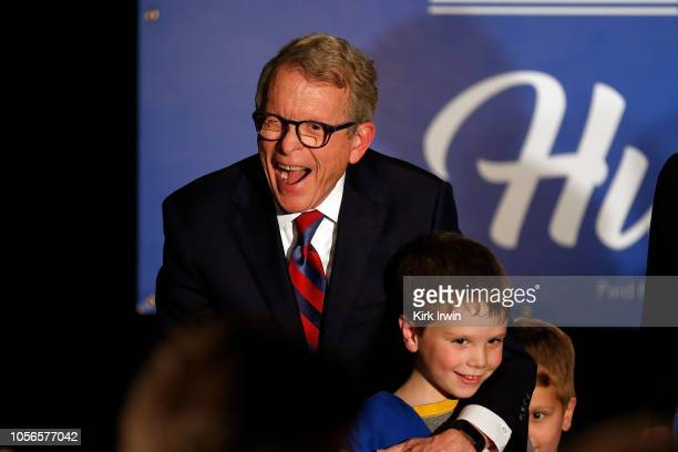 Republican Gubernatorial Candidate Ohio Attorney General Mike DeWine stands on stage with one of his grandchildren after making a late pitch to...