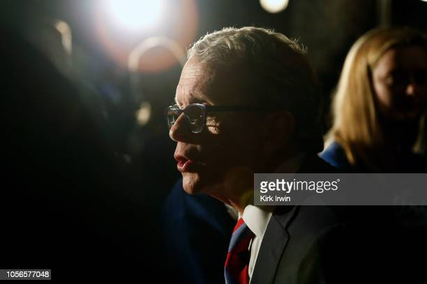 Republican Gubernatorial Candidate Ohio Attorney General Mike DeWine speaks with a supporter following a campaign event at the Boat House at...