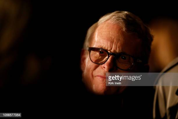 Republican Gubernatorial Candidate Ohio Attorney General Mike DeWine meets with a supporter following a campaign event where he listed reasons as to...
