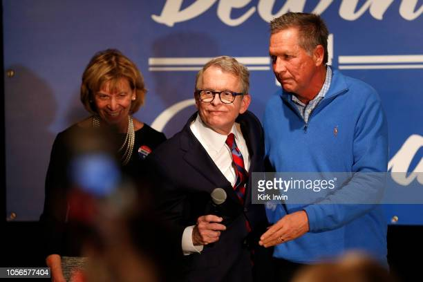 Republican Gubernatorial Candidate Ohio Attorney General Mike DeWine hugs Ohio Governor John Kasich after the governor spoke about why DeWine should...