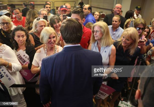 Republican gubernatorial candidate Ron DeSantis greets people as he holds a campaign rally at the Palm Beach County Convention Center on October 6...