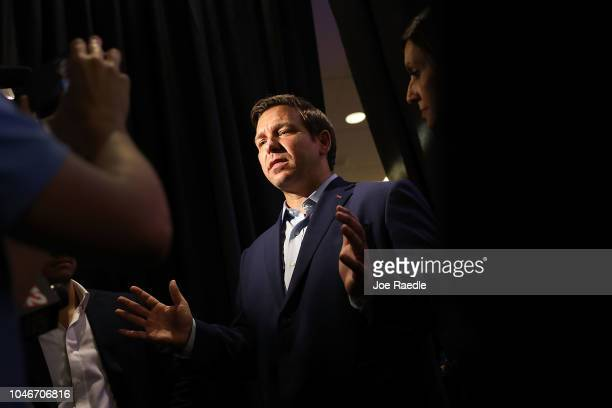 Republican gubernatorial candidate Ron DeSantis speaks to the media as he holds a campaign rally at the Palm Beach County Convention Center on...