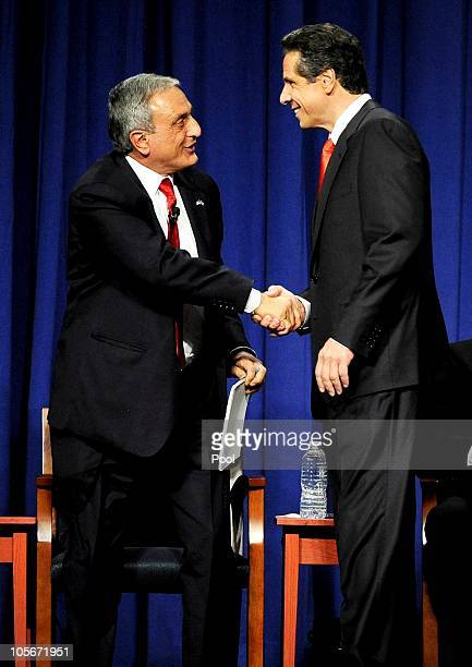 Republican gubernatorial nominee Carl Paladino shakes hands with Democratic gubernatorial nominee Andrew Cuomo before the start of the gubernatorial...