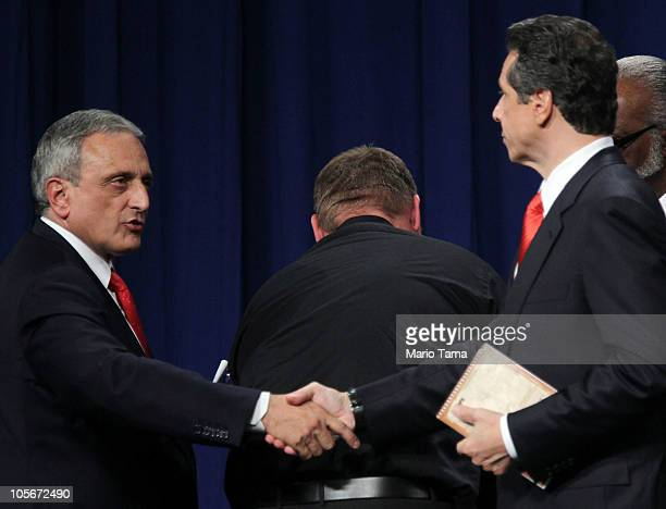 Republican gubernatorial nominee Carl Paladino shakes hands with Democratic gubernatorial candidate Andrew Cuomo at the conclusion of the...