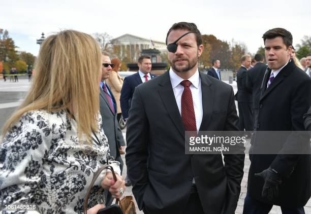 Republican House memberelect Dan Crenshaw is seen after posing for the 116th Congress memberselect group photo on the East Front Plaza of the US...