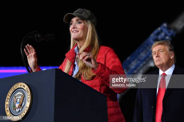 Republican incumbent senator Kelly Loeffler speaks as US President Donald Trump listens during a rally in support of Republican incumbent senators...