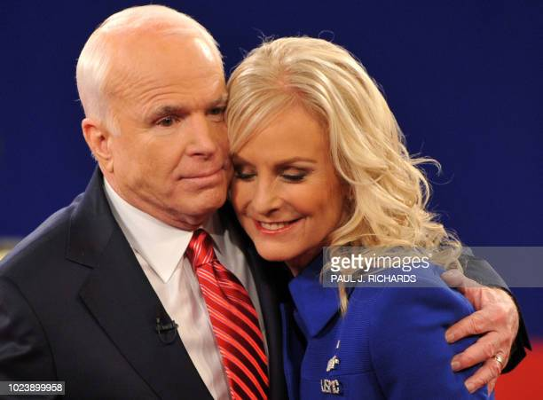 Republican John McCain embraces his wife Cindy following his second presidential debate with Democrat Barack Obama at Belmont University's Curb Event...