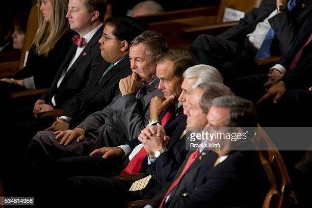 Republican lawmakers listen as US President Barack Obama delivers his first State of the Union address on Capitol Hill in Washington
