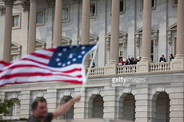 Republican lawmakers opposed to the health care bill stand on a balcony at the U.S. Capitol Building in Washington, on the eve of the historic vote.