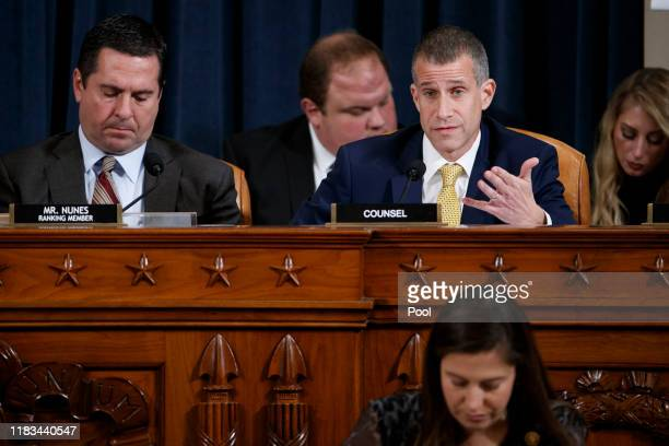 Republican legal counsel Steve Castor with Ranking member of the House Permanent Select Committee on Intelligence Devin Nunes questions Director for...