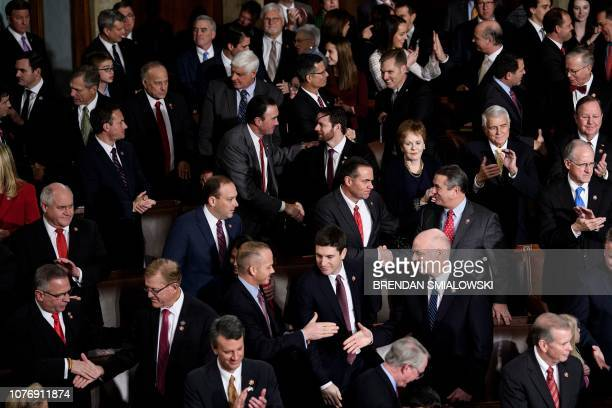 Republican members congratulate each other after being swornin in the House of Representatives during the opening session of the 116th Congress on...