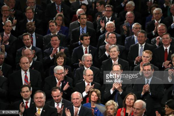 Republican members of Congress attend the State of the Union address in the chamber of the US House of Representatives January 30 2018 in Washington...