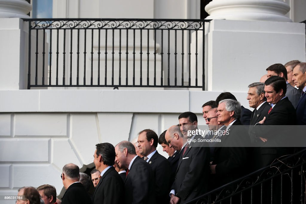 Republican members of Congress line the stairs on the south side of the White House during an event to celebrate Congress passing the Tax Cuts and Jobs Act December 20, 2017 in Washington, DC. The tax bill is the first major legislative victory for the GOP-controlled Congress and Trump since he took office almost one year ago.