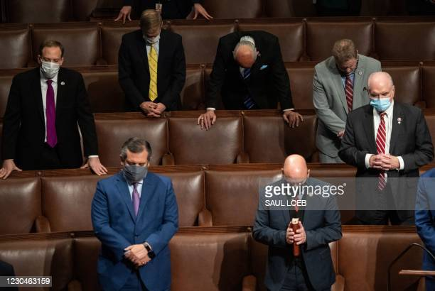 Republican members of Congress pray after US Vice President Mike Pence declared the final electoral vote counts making Joe Biden the next US...