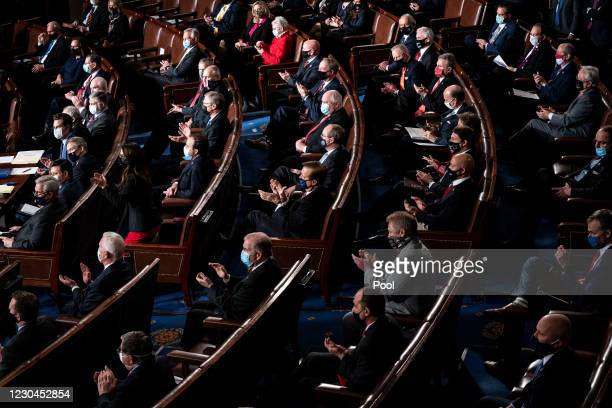 Republican members of the House clap during a joint session of Congress to certify the 2020 Electoral College results on January 6, 2021 in...