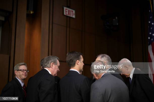 Republican members of the Senate Judiciary Committee huddle before the third day of Supreme Court nominee Judge Brett Kavanaugh's confirmation...