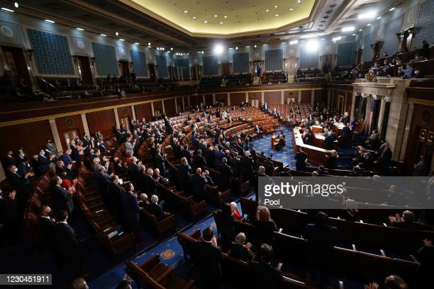 Republican members stand and applaud as Speaker of the House Nancy Pelosi and Vice President Mike Pence preside over the Electoral College vote...