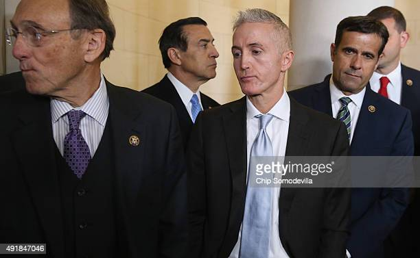 Republican memebers of the House Rep. Bill Roe , Rep. Darrell Issa and House Select Committee on Benghazi Chairman Trey Gowdy react after the...