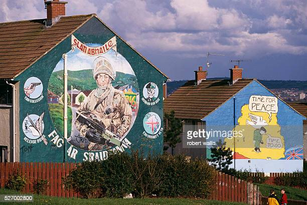 A republican mural on Upper Falls Road in Belfast depicts an Irish soldier while an adjacent mural declares Time for Peace The Northern Ireland peace...