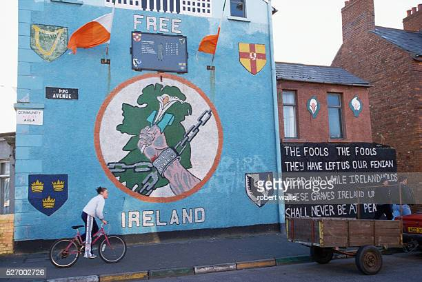 Republican mural on Upper Falls Road in Belfast shows a hand chained by shackles Made in Britain holding a lilly The Northern Ireland peace talks...