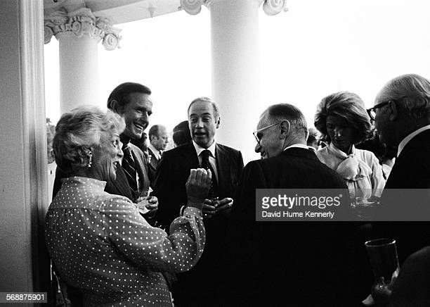 Republican National Committee Chairman George Bush wife Barbara Bush Secretary of Agriculture Earl Butz on the Truman Balcony August 28 1974