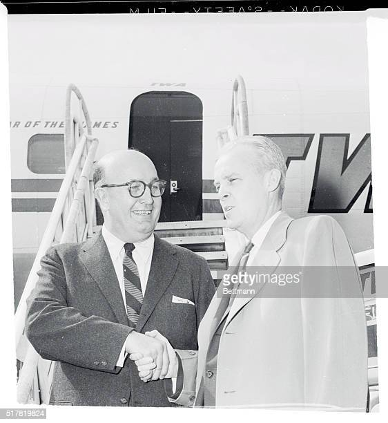 Republican National Committee Chairman Leonard Hall and Democratic Chairman Paul Butler greet each other cordially as they boarded the same plane to...