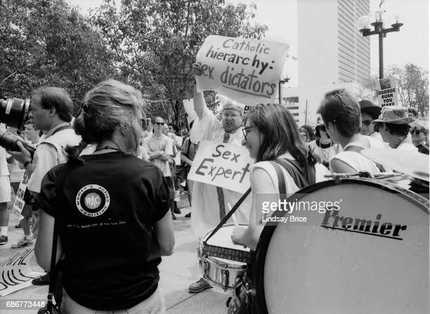 1992 Republican National Convention Protests Queer Nation and ACT UP activists one in costume as a Pope protest the Republican Party the negligence...
