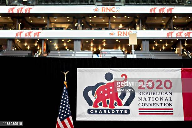 Republican National Convention signage is displayed next to an American flag inside the Spectrum Center during a media walk-through in Charlotte,...