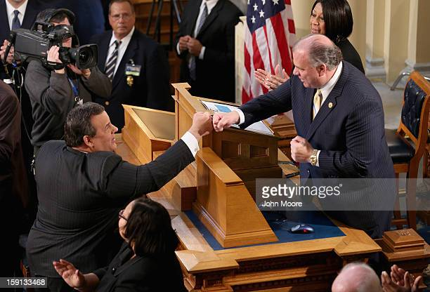 Republican New Jersey Governor Chris Christie greets New Jersey Senate President Steve Sweeney a Democrat before Christie's State of the State...