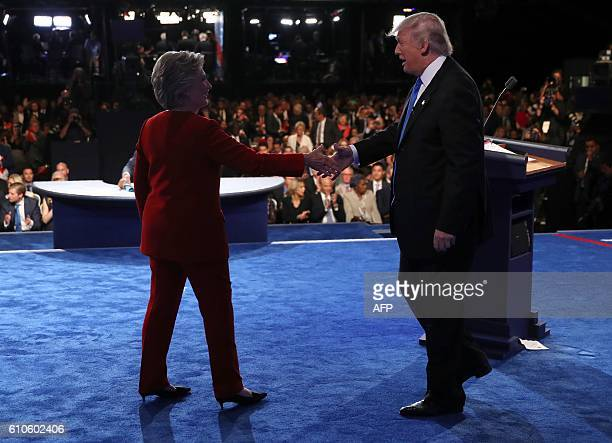 Republican nominee Donald Trump and Democratic nominee Hillary Clinton shake hands at the end of the first presidential debate at Hofstra University...