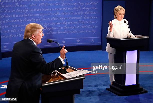 Republican nominee Donald Trump and Democratic nominee Hillary Clinton speak during the final presidential debate at the Thomas Mack Center on the...