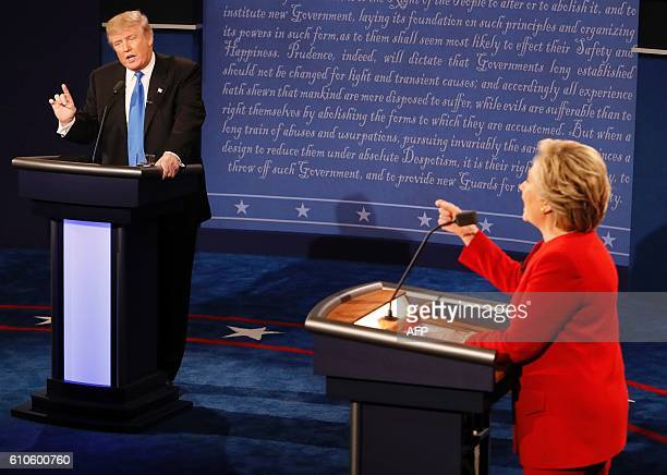 Republican nominee Donald Trump and Democratic nominee Hillary Clinton exchanges during the first presidential debate at Hofstra University in...