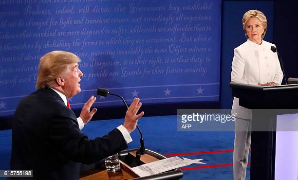 TOPSHOT Republican nominee Donald Trump gestures as Democratic nominee Hillary Clinton looks on during the final presidential debate at the Thomas...