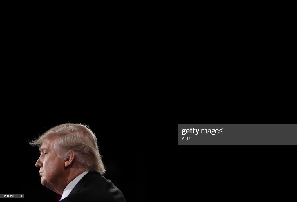 Republican nominee Donald Trump is seen during the first presidential debate at Hofstra University in Hempstead, New York on September 26, 2016. Hillary Clinton and Donald Trump face off in one of the most consequential presidential debates in modern US history with up to 100 million viewers set to tune in. / AFP PHOTO / POOL / joe raedle