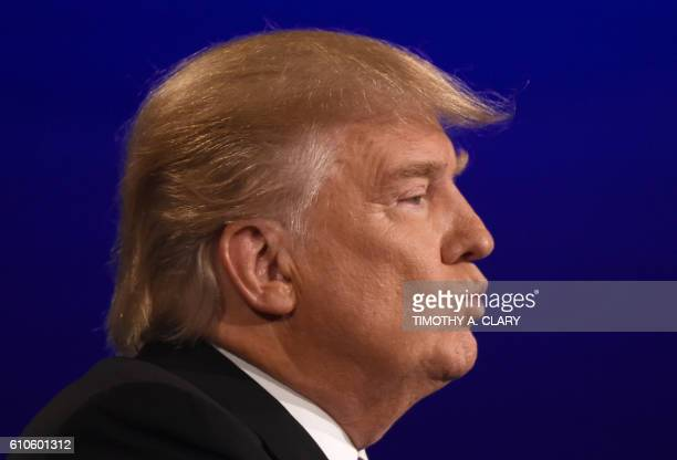 Republican nominee Donald Trump looks on during the first presidential debate at Hofstra University in Hempstead New York on September 26 2016 / AFP...