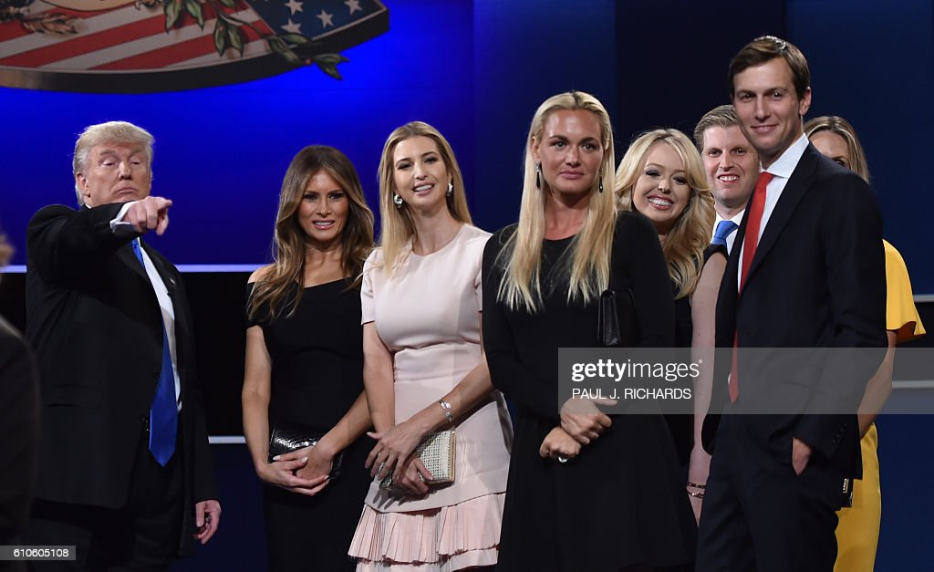 Republican nominee Donald Trump, Melania Trump, Ivanka Trump, Donald Trump Jr.'s wife Vanessa Trump, Eric Trumps wife Lara Yunaska, and Eric Trump look on from the stage after the first presidential debate at Hofstra University in Hempstead, New York on September 26, 2016. / AFP / Paul J. Richards