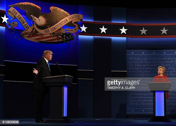 Republican nominee Donald Trump speaks as Democratic nominee Hillary Clinton looks on during the first presidential debate at Hofstra University in...