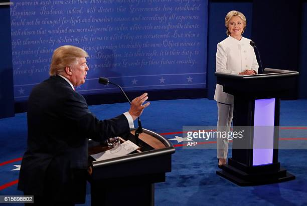 TOPSHOT Republican nominee Donald Trump speaks as Democratic nominee Hillary Clinton looks on during the final presidential debate at the Thomas Mack...