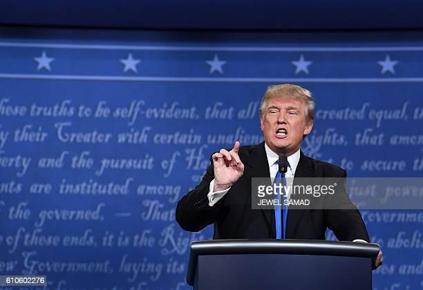 Republican nominee Donald Trump speaks during the first presidential debate at Hofstra University in Hempstead New York on September 26 2016 / AFP /...