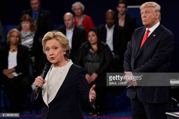 Republican nominee Donald Trump watches Democratic nominee Hillary Clinton during the second presidential debate at Washington University in St Louis...